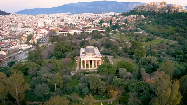 drone video over the temple of hephaestus and the old town of athens, greece - parthenon athens stock videos & royalty-free footage
