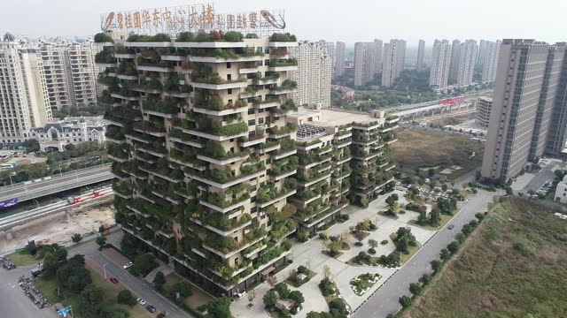 drone video shows balcony's of a residential high-rise building covered with green plants near the community in huangmei town, jurong city, jiangsu... - environmental conservation stock videos & royalty-free footage