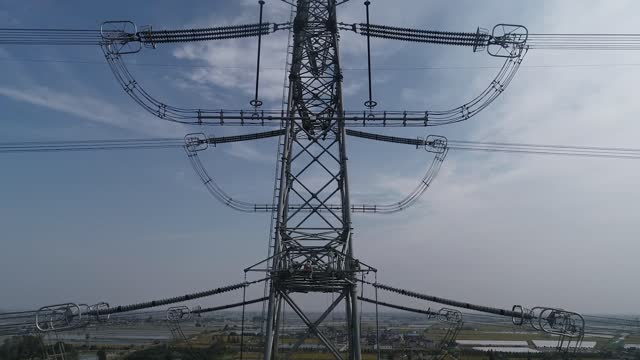 drone video shows engineers maintaining high voltage power lines from great heights in taizhou city, jiangsu province. filmed by: costfoto / barcroft... - electricity stock videos & royalty-free footage