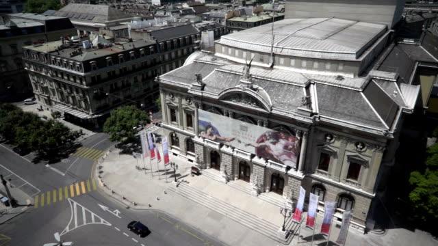 a drone view above geneva grand theatre, switzerland - theateraufführung stock-videos und b-roll-filmmaterial