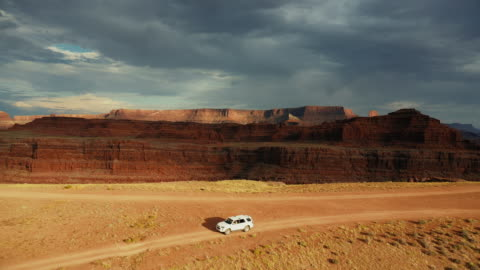 drone view: car at the shafer trail canyonlands - moab utah stock videos & royalty-free footage