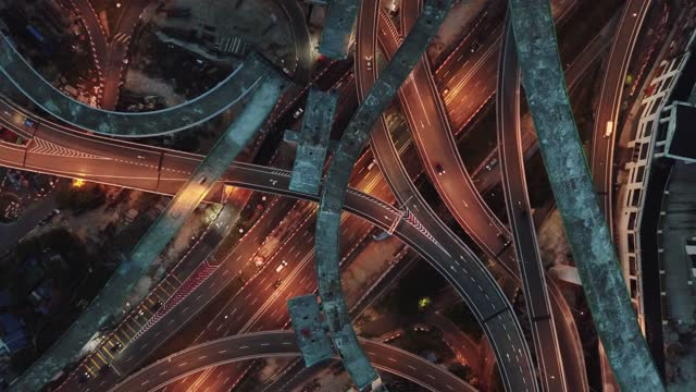 drone view directly above night scene city with elevated road bridges cross junction - major road stock videos & royalty-free footage