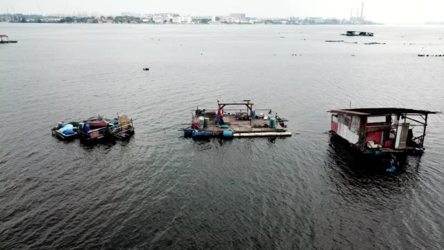 A drone view dock boat houses on johor straits in Masai Malaysia
