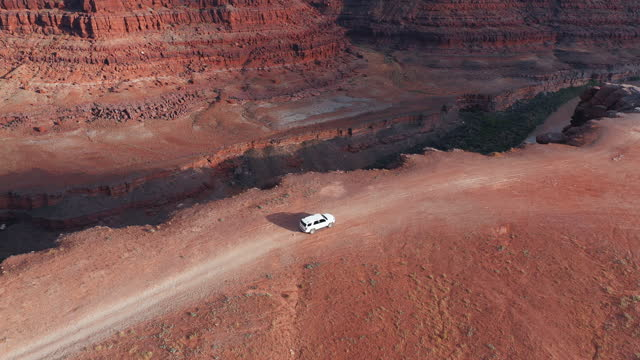 drone view: flying over a off road car at the shafer trail canyonlands - moab utah stock videos & royalty-free footage