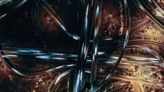 t/l drone view, light trail of overpass at night - complexity stock videos & royalty-free footage