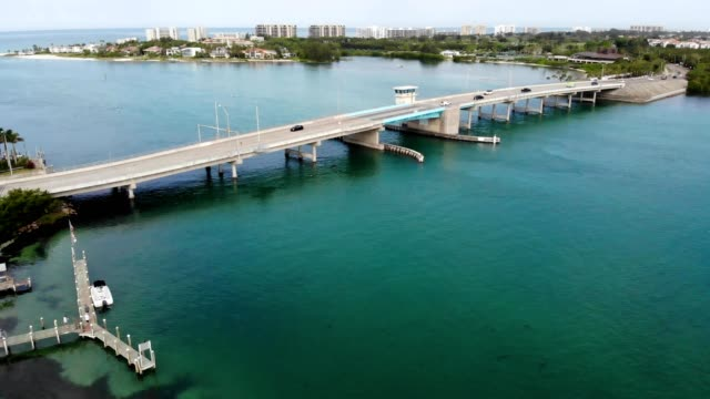 a drone view of a bascule drawbridge in longboat key florida - drawbridge stock videos and b-roll footage
