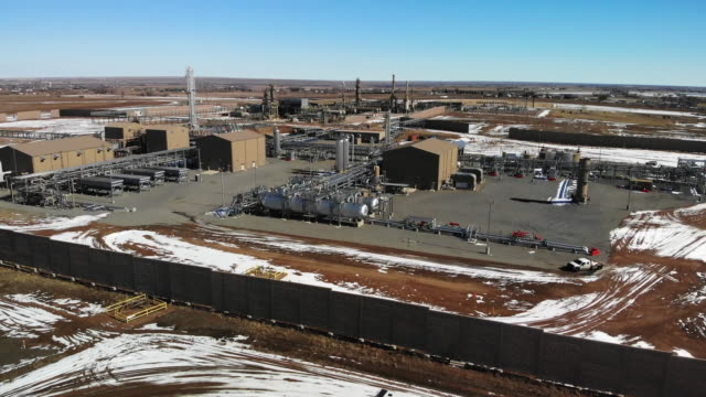 a drone view of a gas and oil refinery or pumping station in eastern colorado in the winter - pumping station stock videos & royalty-free footage