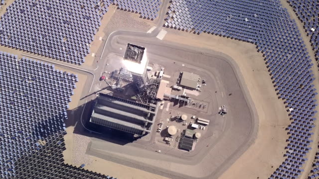 drone view of a giant solar collection farm - power supply stock videos & royalty-free footage