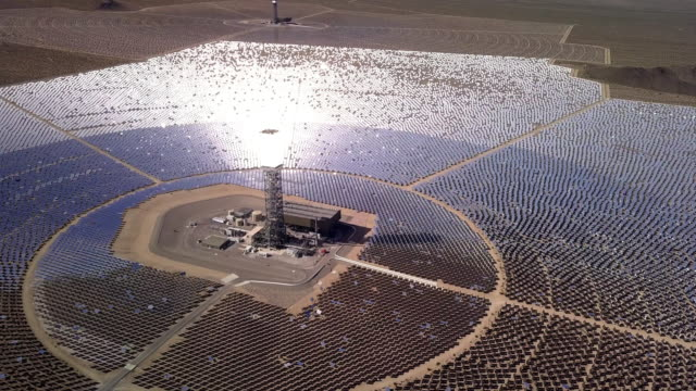 drone view of a giant solar collection farm - concentration stock videos & royalty-free footage