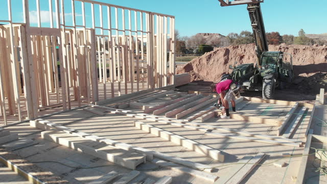 drone view of a house being framed by workers - roof stock videos & royalty-free footage