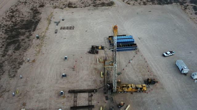 drone view of a portable oil or gas drill fracking rig pad - montana western usa stock videos & royalty-free footage
