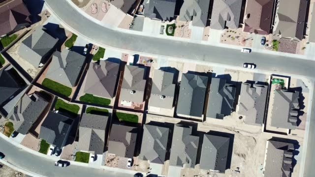 drone view of a residential neighborhood - housing difficulties stock videos & royalty-free footage