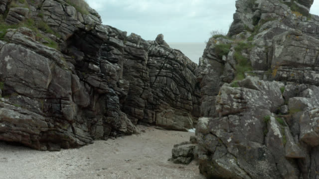 drone view of a rocky shore in south west scotland - johnfscott stock videos & royalty-free footage