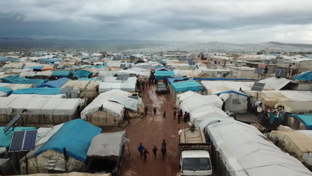 drone view of a sprawling refugee camp on the syria-turkey border - alien stock videos & royalty-free footage