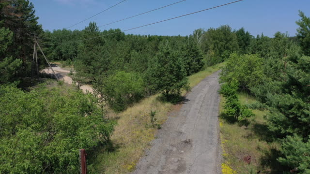 a drone view of abandoned checkpoint through the 10 km exclusion zone in chernobyl on june 17 2019 the chernobyl disaster was a catastrophic nuclear... - metric system stock videos and b-roll footage