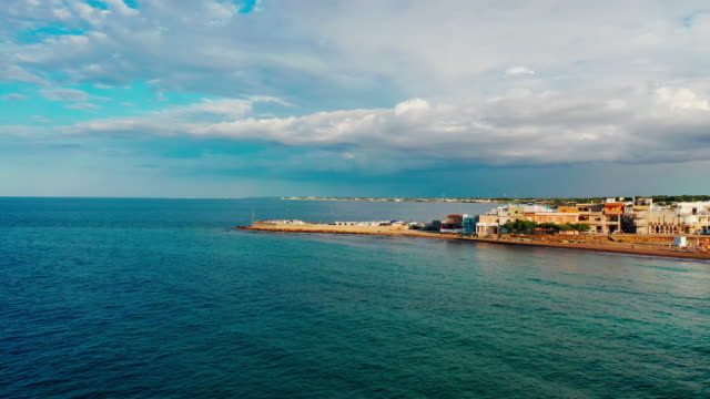 drone view of adriatic coast between campo di mare and torre san gennaro, puglia, italy, on may 31, 2019. - mare adriatico video stock e b–roll