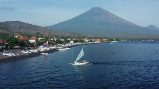 drone view of amed fishing village in bali indonesia - bali stock videos & royalty-free footage