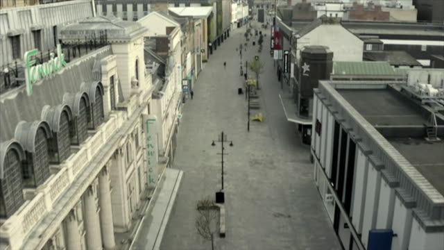 drone view of an empty high street in swindon during the coronavirus crisis - aerial view stock videos & royalty-free footage