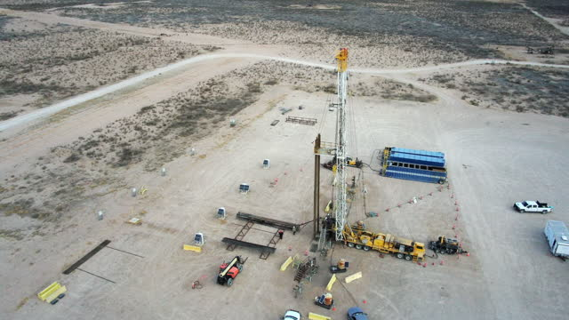 drone view of an oil or gas drill fracking rig pad - montana western usa stock videos & royalty-free footage