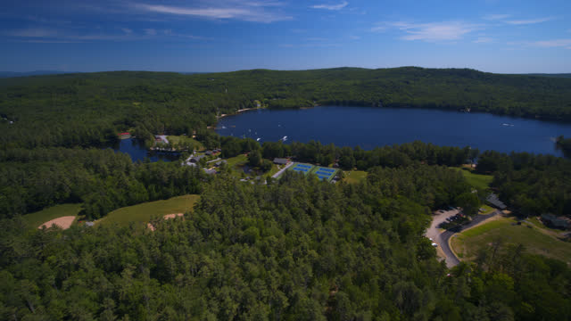 drone view of beautiful lake surrounded by summer camp on a sunny day - new england usa stock videos & royalty-free footage