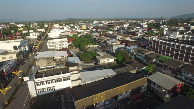 drone view of buildings and descend over clock tower in central chiang rai - chiang rai province stock videos and b-roll footage