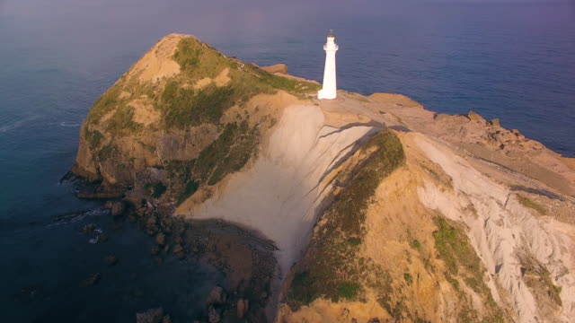 Drone view of Castlepoint Lighthouse during sunset.