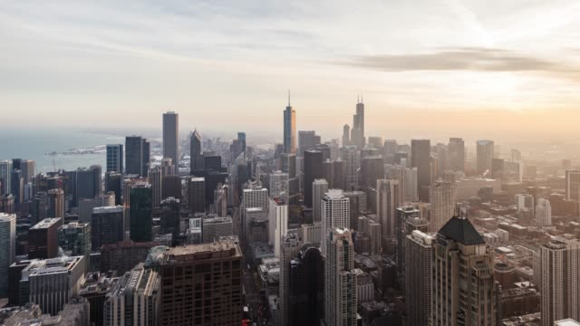 t/l drone view of chicago skyline in sunlight at sunset - chicago loop stock videos and b-roll footage