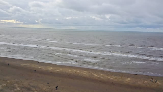 4k drone view of coastline - netherlands stock videos & royalty-free footage