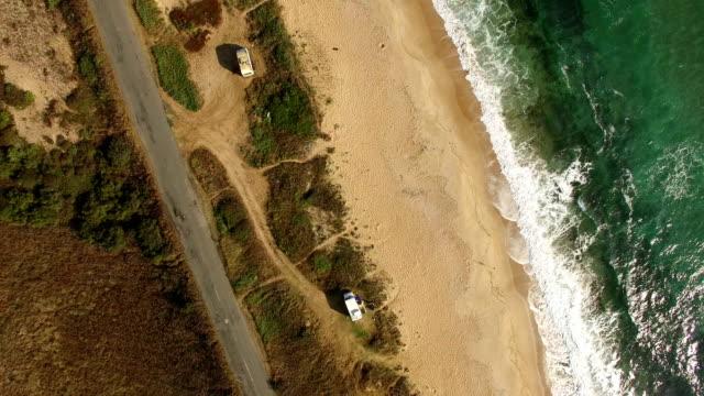 4k drone view of coastline - camper van stock videos & royalty-free footage
