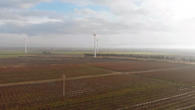 drone view of countryside field and windmills - responsibility stock videos & royalty-free footage