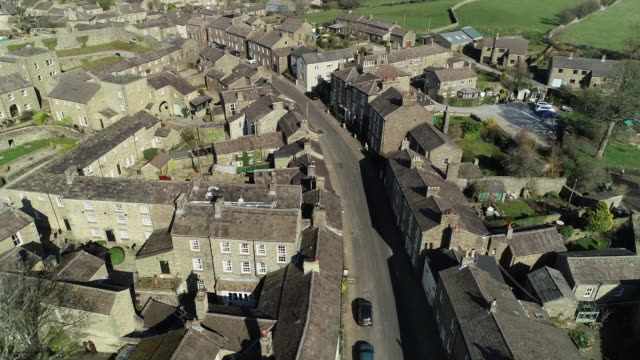 drone view of deserted village of askrigg during the covid-19 outbreak on 28 march 2020 in yorkshire dales national park, united kingdom - village stock videos & royalty-free footage