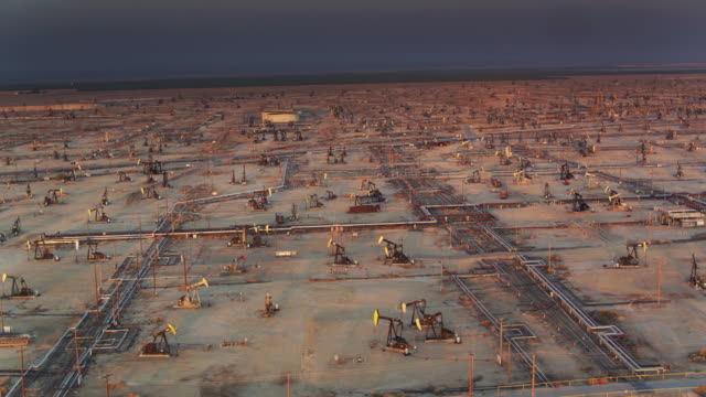 drone view of enormous oil field near missouri triangle, ca - fossil fuel stock videos & royalty-free footage