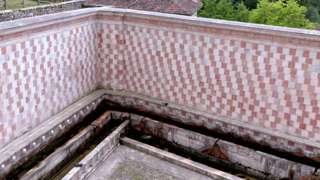 drone view of fountain of the 99 spouts l'aquila abruzzo italy - circa 13th century stock videos and b-roll footage