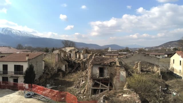 a drone view of historic village of onna on march 6 2019 about ten years on from the april 6 2009 earthquake that struck the abruzzo region of italy... - aquila video stock e b–roll