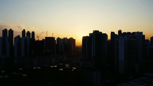 drone view of hong kong city at sunset - town stock videos & royalty-free footage