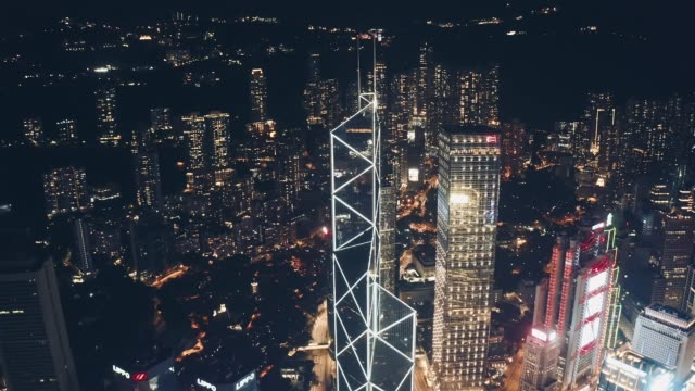 drone view of hong kong city skyline at night - central district hong kong stock videos & royalty-free footage