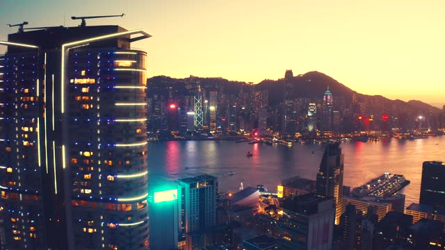 drone view of hong kong cityscape at sunset - majestic stock videos & royalty-free footage