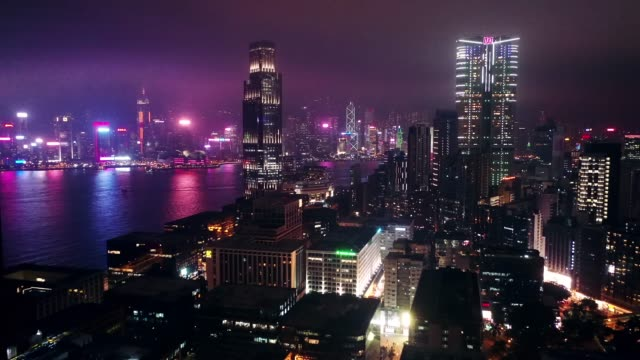 drone view of hong kong kowloon city skyline at night - city stock videos & royalty-free footage