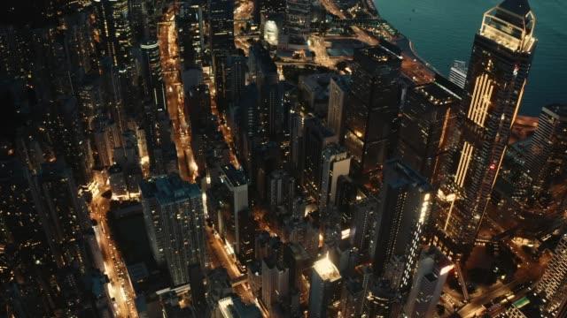 drone view of hong kong night cityscape - central plaza hong kong stock videos & royalty-free footage