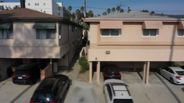 drone view of houses and cars in hayworth dingbat apartment historic district in los angeles, ca, u.s. on friday, july 23, 2021. los angeles county... - american culture stock videos & royalty-free footage