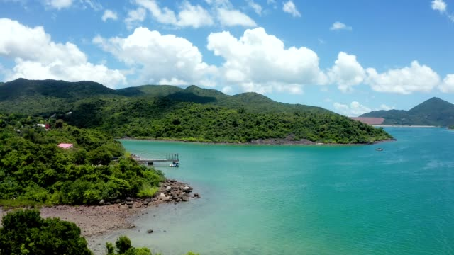 drone view of island in sai kung village, hong kong - lagoon stock videos & royalty-free footage