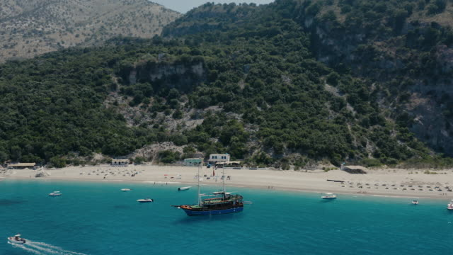 drone view of kroreza beach with clear green water - albania stock videos & royalty-free footage