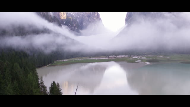 A drone view of Lake Dobbiaco in Dobbiaco Italy on September 12 2017 Lake Dobbiaco is a small alpine lake near the homonymous village in upper Val...
