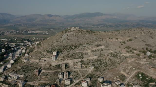 drone view of lëkurësi castle in the city of sarandë albania - albania stock videos & royalty-free footage
