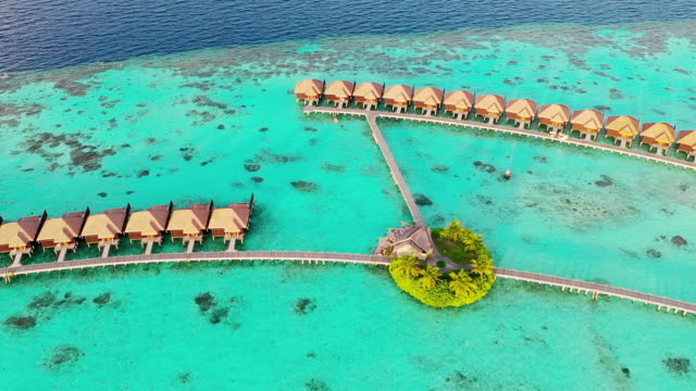 drone view of luxury villas in maldives - tropical climate stock videos & royalty-free footage