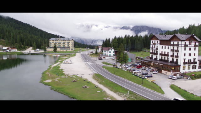 drone view of misurina lake, in misurina, italy, on september 13, 2017. lake misurina is the largest natural lake of the cadore and it is 1,754 m... - tre cimo di lavaredo stock videos & royalty-free footage