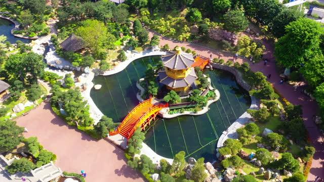 drone view of nan lian garden, chi lin nunnery, diamond hills, hong kong - shrine stock videos & royalty-free footage