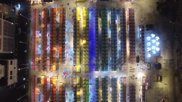 drone view of neon night market in pratunam has opened up on a stretch of vacant land on petchaburi road, between sois 23 and 29, close to platinum... - night market stock videos & royalty-free footage