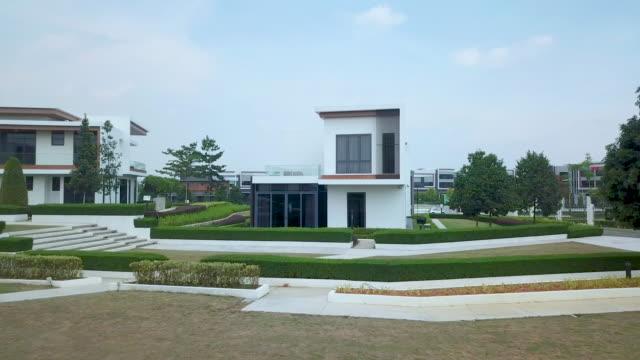 vidéos et rushes de drone view of new bungalow and its neigbouring enviroment. - lotissement