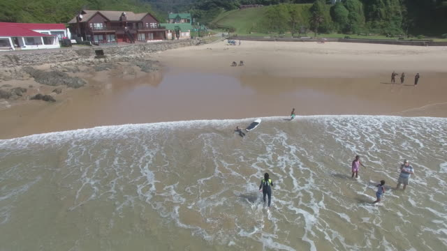 Drone view of People surfing in sea / Cape Town, Western Cape, South Africa